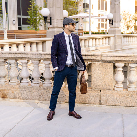 Vandre premium charcoal flannel hat styled by Dapper Professional wearing a blazer, tie and chinos holding a briefcase ready for the work day.