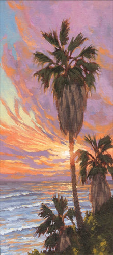 Sunshine creeps around the edges of a palm tree at sunset. Swami's Beach, Encinitas, Califonia