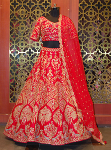 Red Lehenga Choli In Raw Silk With Resham And Zardozi Embroidered Floral Motifs