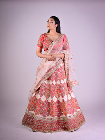 Peachish Pink Silk Lehenga With Pink And Orange Floral Motifs