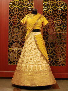 Chrome Yellow and Off-White draped Lehenga