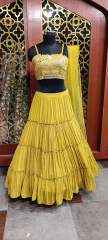 Clean georgette  heavy flared skirt with heavy strapped blouse