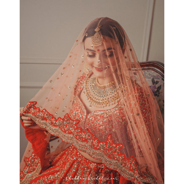Red Bridal Lehenga with peach scalloped duppatta