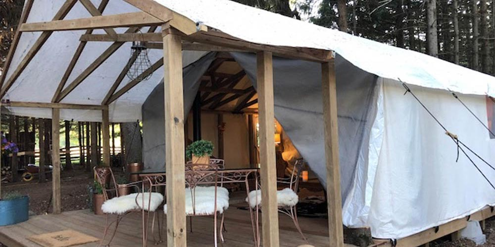 Glamping tents with wooden porch