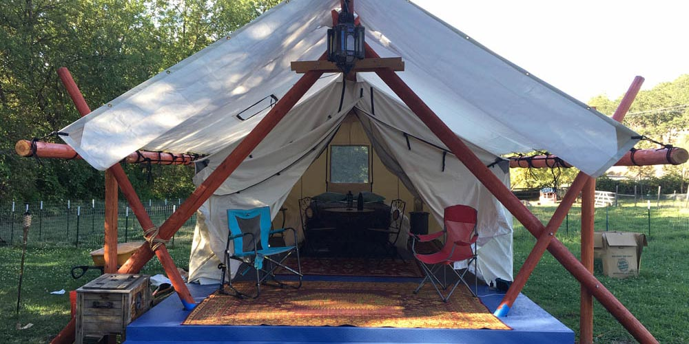 Glamping tent with log frame
