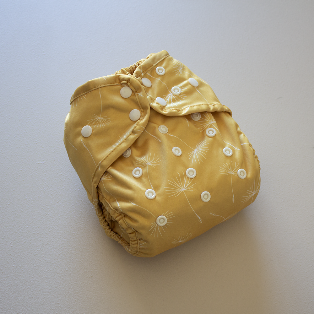 Brooksies reusable nappy diaper cover sold by Kekoa. PUL TPU outer and colour dandelion