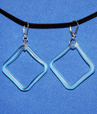 Square glass earrings from a Bombay Sapphire bottle.