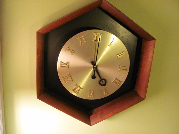 Clock: Hex Case Wall Clock.  Designed by George Nelson / Umanoff for Howard Miller