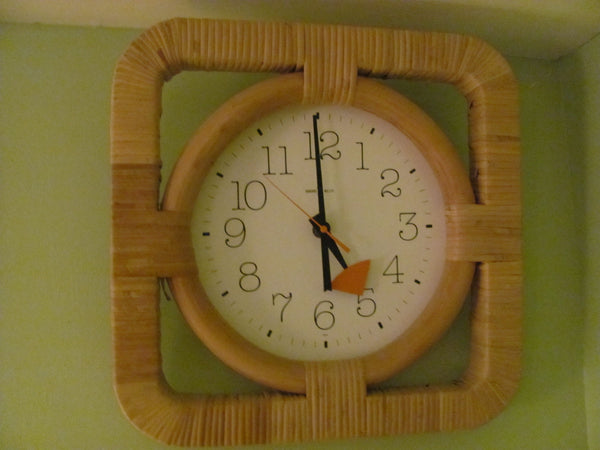 Clock: Howard Miller Model 622-654 Rattan Wall Clock. Designed by George Nelson