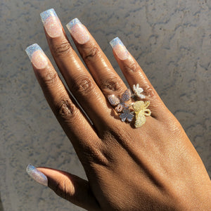 Clear glitter nails on manicure hand.