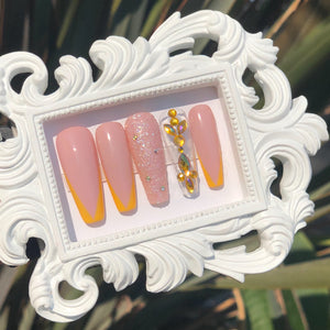 Tan press on nails with yellow French tip and multicolor yellow base  gems