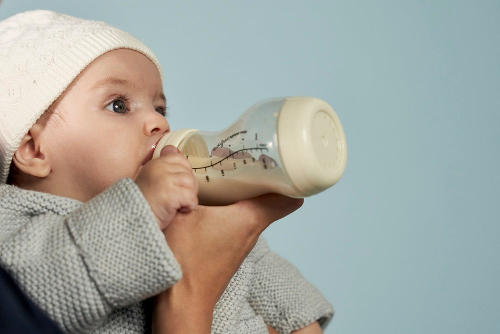 Baby is fed from S baby bottle