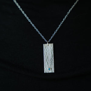 Textured Silver Rectangle Pendant with a Paraiba Topaz stone