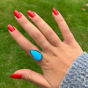 Sleeping Beauty Natural Turquoise Teardrop Stone in Beaded Surround on a Silver Ring Band , Size UK O, US 7