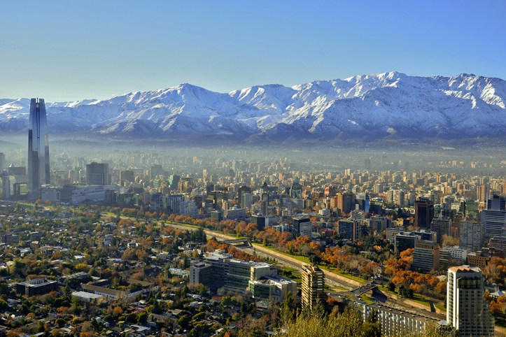 Between chilean mountain range and snow capped Andes, beautiful Santiago is nestled.