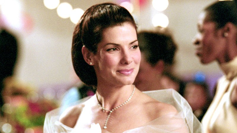 Sandra Bullock as Lucy Kelson from Two Weeks Notice is a Leo Zodiac Movie Character