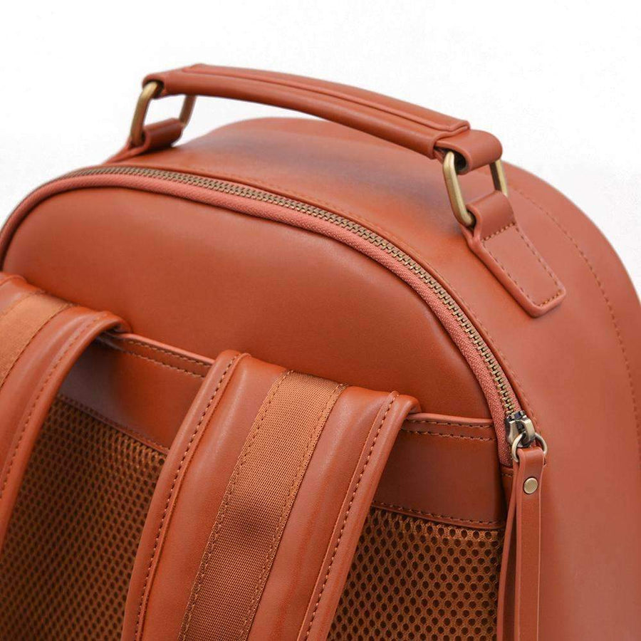 Laptop sleeve on tan vegan leather backpack by Refined Traveler