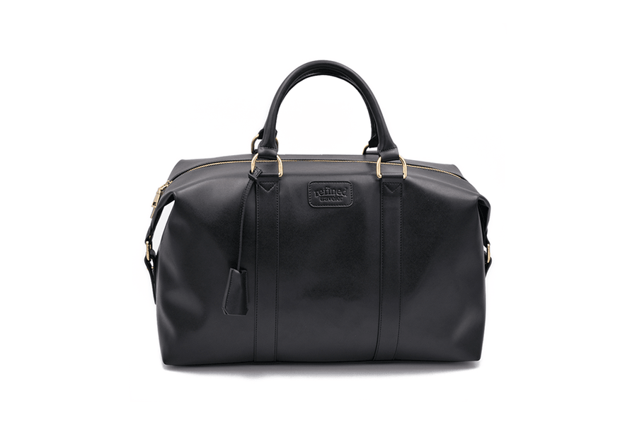 Front view of black vegan leather duffel bag by Refined Traveler