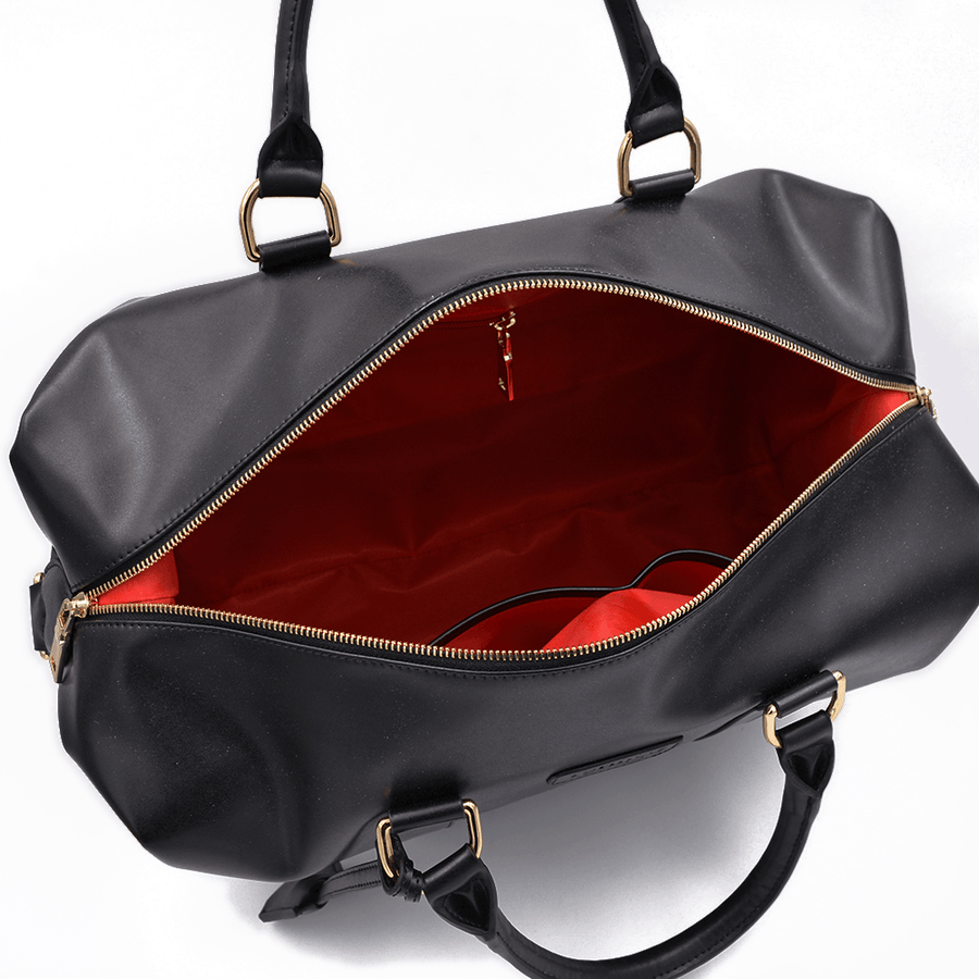 Interior view of black vegan leather duffel bag by Refined Traveler