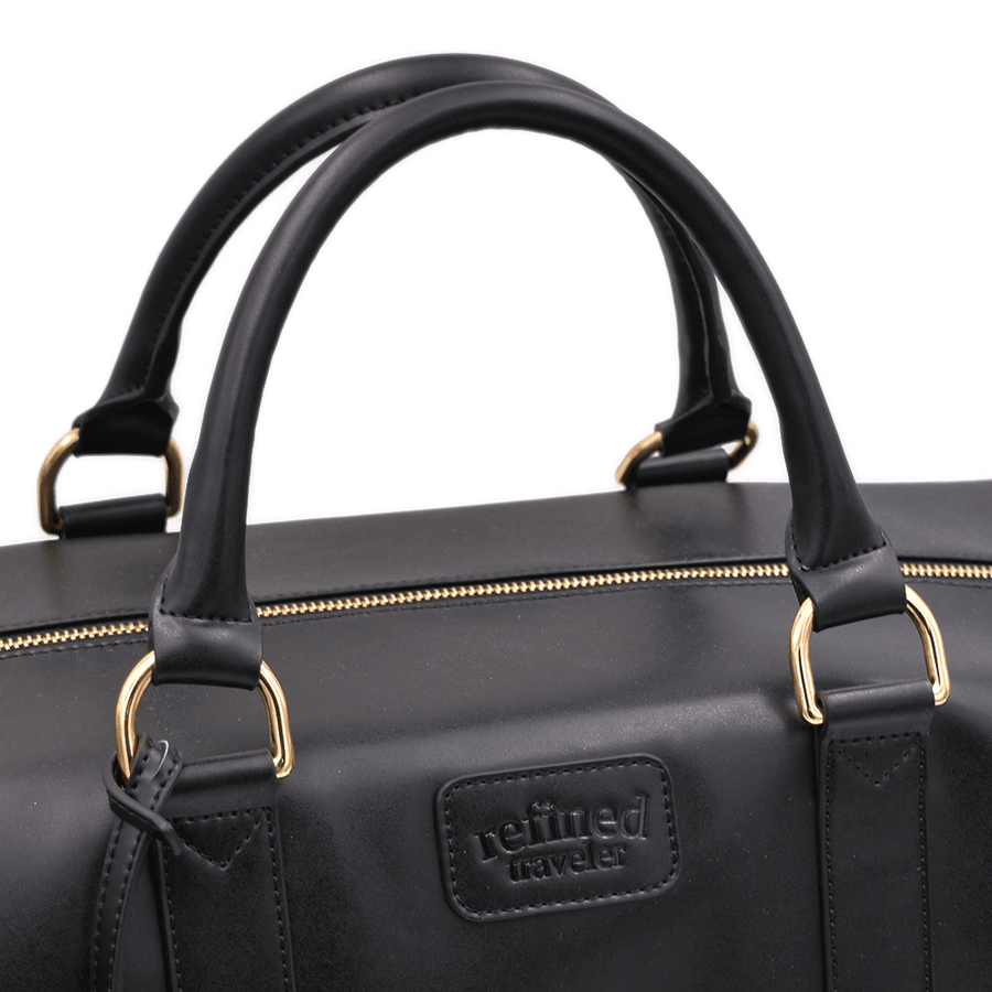 Bag handle view of black vegan leather duffel bag by Refined Traveler