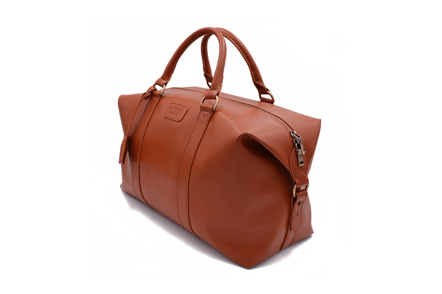 Side view of tan vegan leather duffel bag by Refined Traveler