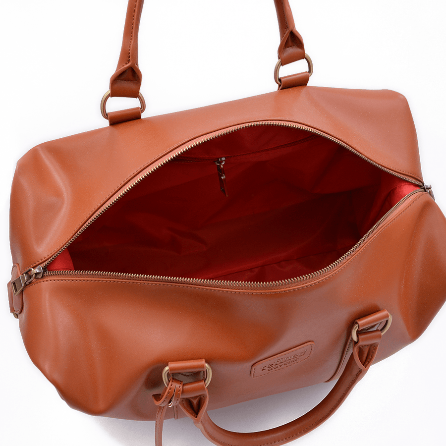 Interior view of tan vegan leather duffel bag by Refined Traveler