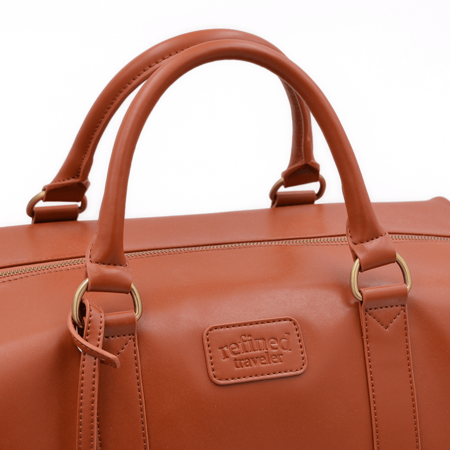 Bag handles on tan vegan leather duffel bag by Refined Traveler