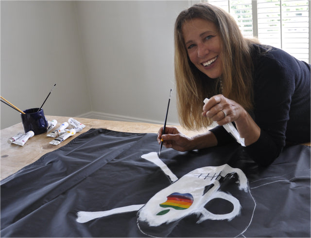 Susan Kare hand painting canvas pirate flag