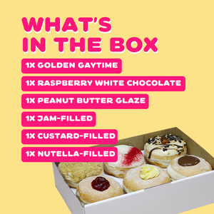 Donut box with custard, nutella, and jam filled donuts, golden gaytime, white chocolate, and peanut butter glazed donuts