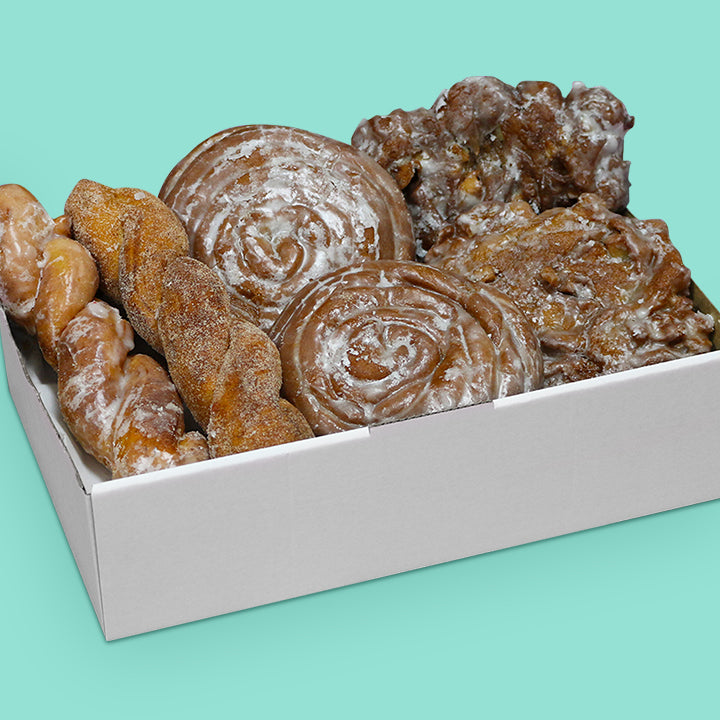 donut box with apple fritters, cinnamon scrolls, cinnamon twister and OG twister.