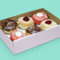 Vegan donut box with jam filled, red velvet with cream cheese, and chocolate jam with rainbow sprinkles donuts