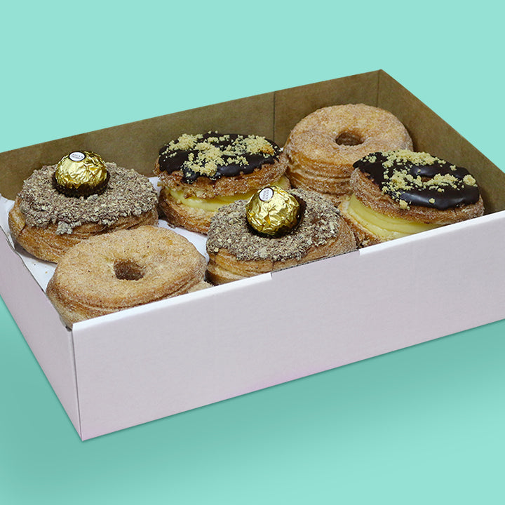 Cronut box with Nutella and Ferrero Rocher, honeycomb, and cinammon cronuts