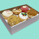 Gourmet donut box including Golden Gaytime & honeycomb custard donut, raspberry white chocolate & jam donut etc.