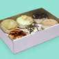 Gourmet donut box including creme brulee with custard donut, cookies & cream cheesecake donut etc.
