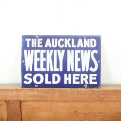 Sold! Auckland weekly news enamel sign