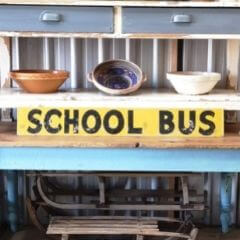 Vintage hand painted school bus sign