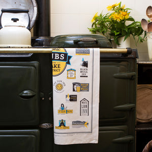 Iconic Pubs of the Lake District Tea Towel on an AGA