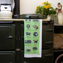 Load image into Gallery viewer, Herdwicks of the Lake District Tea Towel on an AGA
