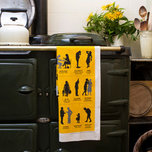Load image into Gallery viewer, Cumbrian Insults Tea Towel on an AGA