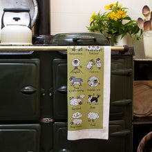 Load image into Gallery viewer, Swaledales of Yorkshire Tea Towel on an AGA