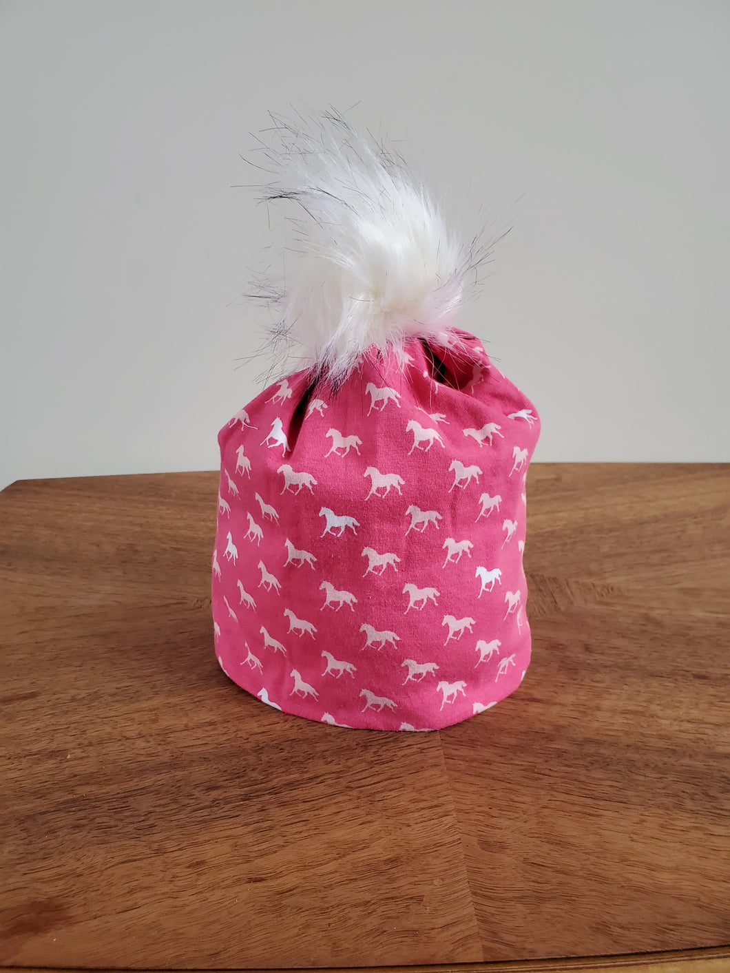 Stretch cotton knit hat with snap off pompom. Easy wash, comfy wear