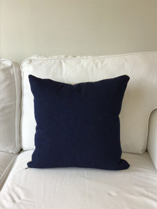 Cream colored pillow with chocolate plaid numbers and blue CN Tower.