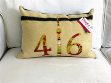 Load image into Gallery viewer, Felted Wool Blanket Pillow - Cream background with fine black stripe. Coordinating rust, mustard & moss green numbers and CN Tower