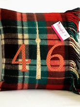 Load image into Gallery viewer, Winter plaid pillow with rust numbers and cream CN Tower.
