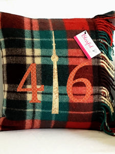 Winter plaid pillow with rust numbers and cream CN Tower.
