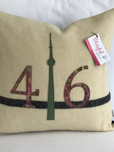 Load image into Gallery viewer, Cream pillow with modern black stripe.  Batik numbers and green check CN Tower.