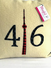 Load image into Gallery viewer, Felted Wool Blanket Pillow - Cream colored background with navy check numbers and red plaid CN Tower.