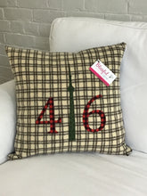 Load image into Gallery viewer, Felted Wool Blanket Pillow - Cream background with chocolate brown squares. Red plaid numbers and moss green CN Tower.