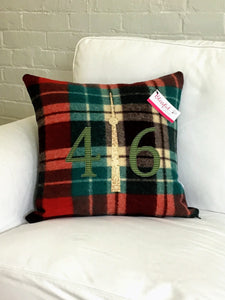 Christmasy plaid with green numbers and cream CN Tower