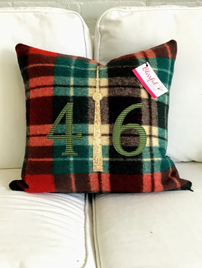 Felted Wool Blanket Pillow - Christmasy plaid background with moss green check numbers and mottled cream CN Tower